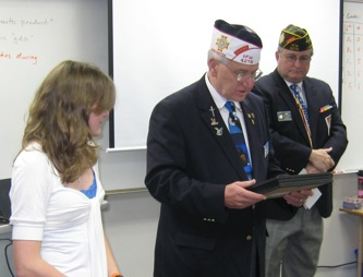Janelle receives her honorable mention from the VFW member.