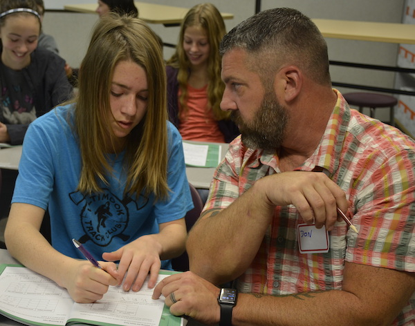 CCMS student and father participate in writing activity