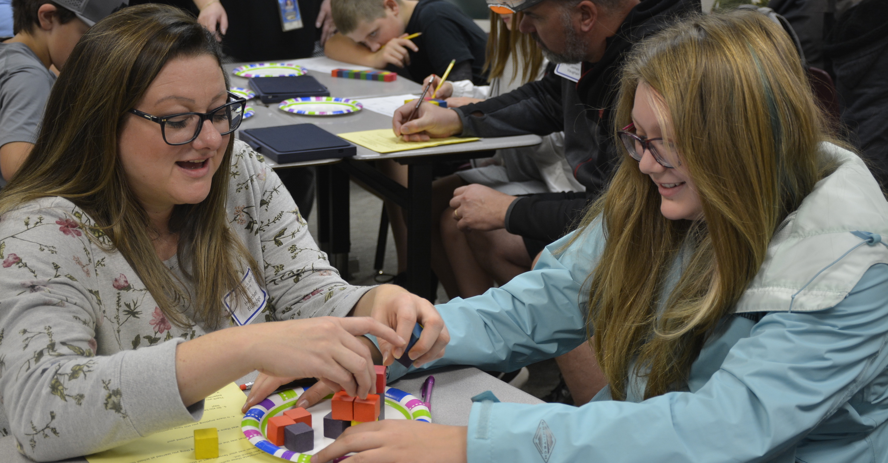 CCMS parent and student participate in activity with colored blocks