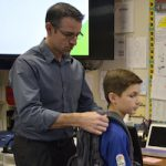 Gause student receives posture assessment from local chiropractor