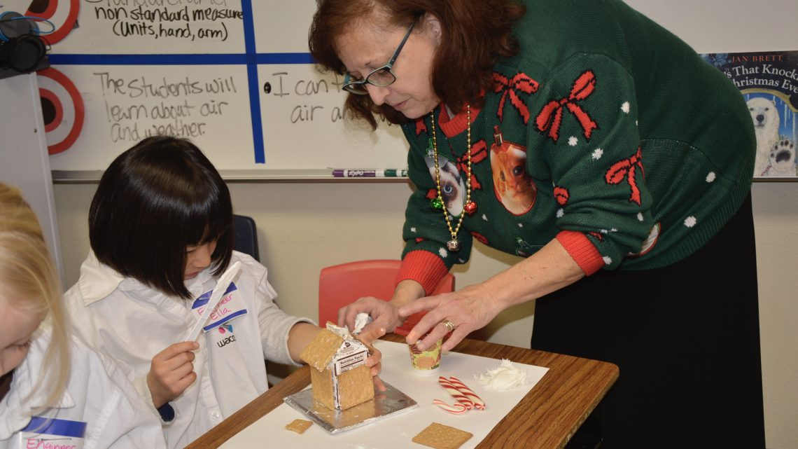 Constructing Gingerbread Houses in First Grade!