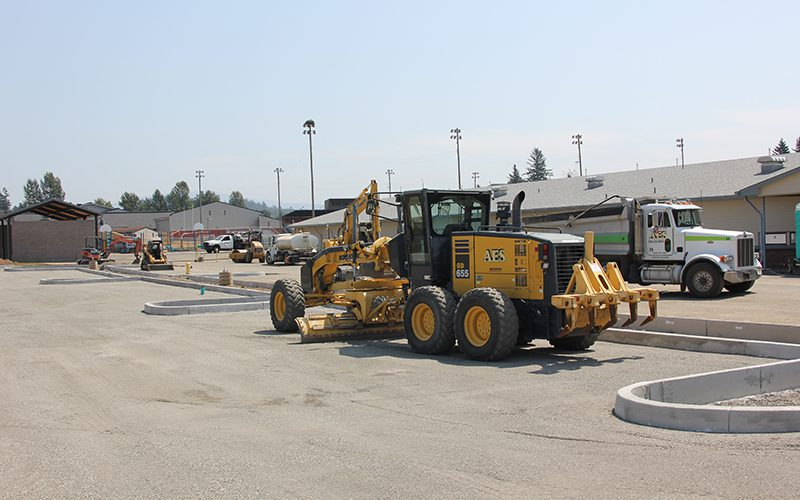 Grader in north parking lot flattening surface for paving