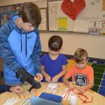 Middle School Student helps younger students with project