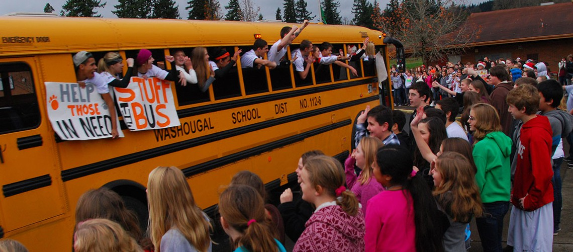 "Students from WHS and JMS rallying to ""stuff the bus"" with food for local families"
