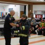 Greg Payne, a firefighter with the Camas-Washougal Fire Department, helps seventh-grader Hailey Bachteler put on the required equipment used for entering a burning structure. It can weigh up to 80 pounds.