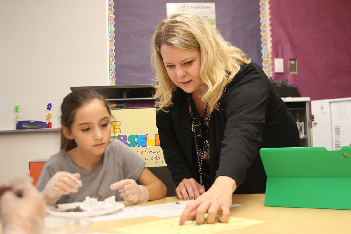 Heidi Kleser and student during science lesson