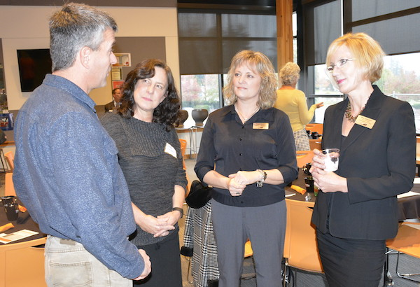 Event attendee John Spencer talks with Superintendent and board members at CTE event
