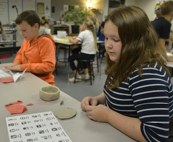 Students work with Clay as part of an Art lesson around sculpture