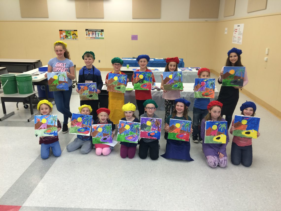 Student artists displaying their drawings of a landscape, with students wearing berets