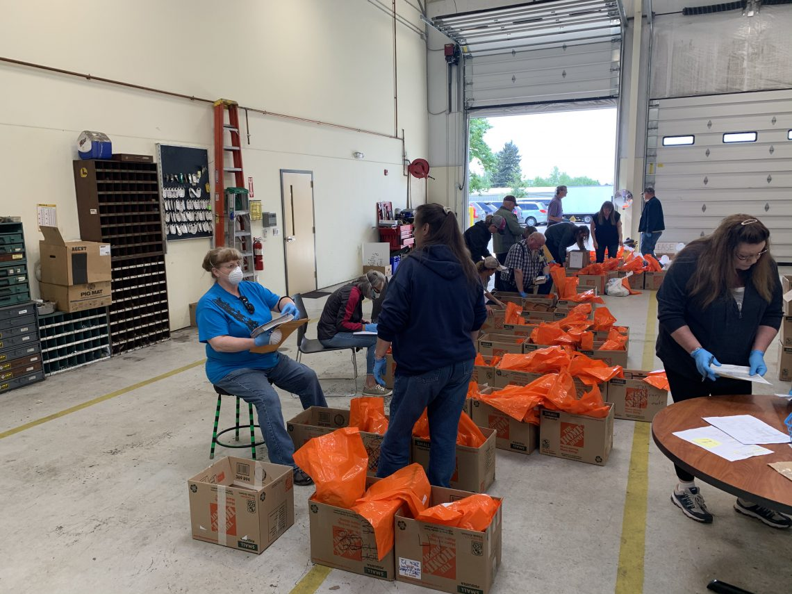 WSD Transportation workers sort food boxes